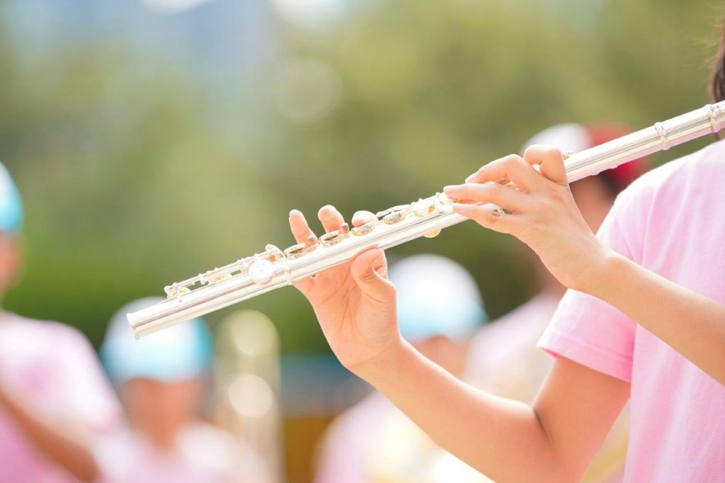 child-playing-flute-sports-day-elementary-school